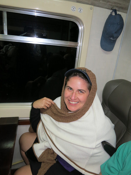 Babushka!!!<br /><br />So, they have fashion shows on the trains in Peru - literally they start playing music, and the employees use the aisle way as the runway and model - Kay loved the alpaca scarf, and was trying it on.  And purchased it. Dammit, PeruRail, didn't you have enough from my wallet?
