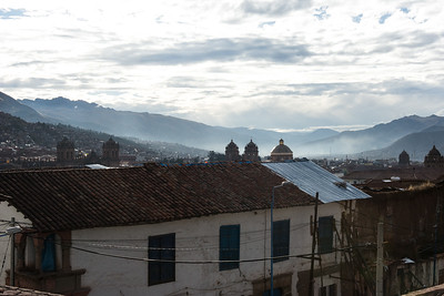 Early morning view over Cusco. Fog in the valley.