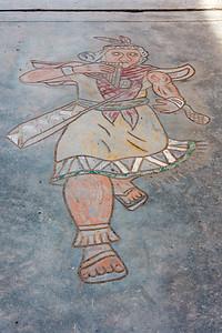 Inca figure on the sidewalk.
