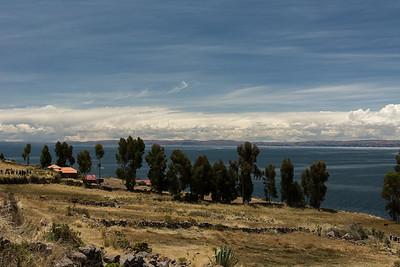 Overlooking farm land out to Lake Titicaca.