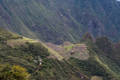 View Machu Picchu  with terraces, stairways and Huayana Picchu (back right).