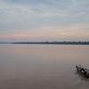 Ucayalli River: Skiff leaving riverboat at sunrise