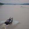 Ucayalli River: Skiffs leaving riverboat at sunrise