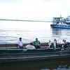 Iquitos: Crew in skiffs at twilight