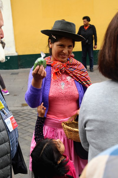 Indigenous woman trying to sell us coca leaves