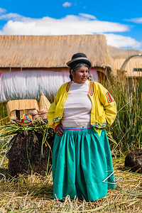 She is the boss of this island. Giving us the tour. how they build these islands using the grass that grows on the lake titicaca..