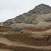 The Cerro Blanco rises up behind the Huaca de la Luna.  On the terrace in the picture, archaeologists found many skeletons of human sacrifices.