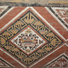 """Painted wall decorations of the """"Decapitator God"""" that were recovered intact during the excavations."""