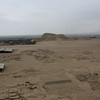 View of the Huaca del Sol with the remains of the Moche town in the foreground.