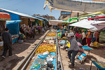 Traders re-establishing their stalls after our train has passed over them at Juliaca, Peru