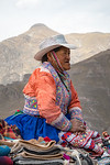 A road-side trader in traditional costume on the road into the Colca Canyon