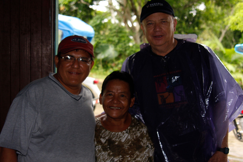 (Photo 0107)  Local Guide Paul, owner of the refreshment stand and Program Manager Roberto Rocafort in Indiana, Peru.
