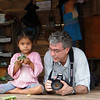 (Photo 0275)  Ralph making friends with the little girl and family who live on the Amazon River.