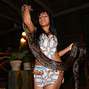 (Photo 0348)  Young lady carrying an anaconda snake and walks around the audiance with it.