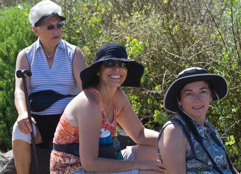 Pat, Robyn and Judith resting near the blow hole on Española Island.