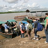 Public Health students board boats at Nauta.  The river is quite low (note bridge in background).