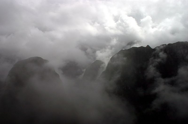 The morning we were to visit Machu Pichu turned out to be a very cloudy one. This picture was taken as we are nearing the top of the mountain were the lost city of Machu Pichu is located. The cloud canopy was very low at dawn, but by the time we got to Machu Picchu it had cleared just enough that we could see the main square with out much problem.  Machu Pichu is located in Cusco. Cusco is a city located about 560 miles south of Lima (the capital of Peru...where I am originally from).