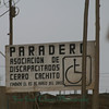 This sign sits at the entrance to a recent 'invasion', done by an association of disabled persons.  They claimed land low in the hills, near the ocean, as a group -- staking claim to the land on the 23rd of March, 2003.
