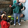 Paul juggles for the kids in the home.
