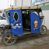 Mototaxi, decorated and with doors to keep out the cold, damp air.