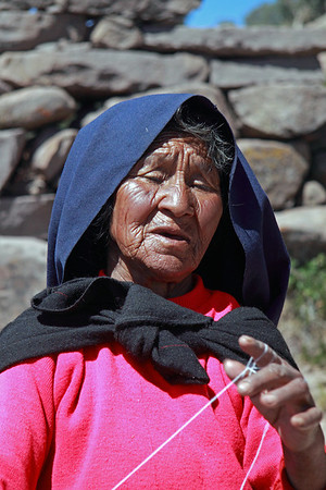 Titicaca 5370<br /> Old woman spin weaving on the trail from Port Alsuno on Taquile Island on Lake Titicaca
