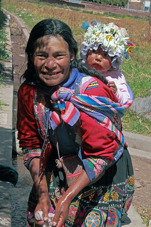 Pisac 4046<br /> Woman with her baby doing laundry in Pisac