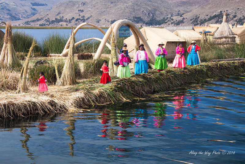 Titicaca 5711<br /> Welcoming villagers on a Uros Island on Lake Titicacca.