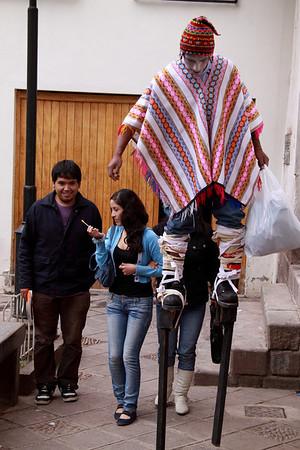 Participant in a parade around the Plaza De Armas.