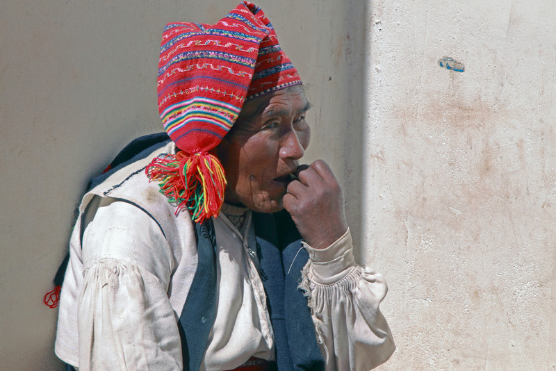 Titicaca 5427<br /> Old man taking a coco leaf after getting to the village at the top of the trail on Taquile Island.
