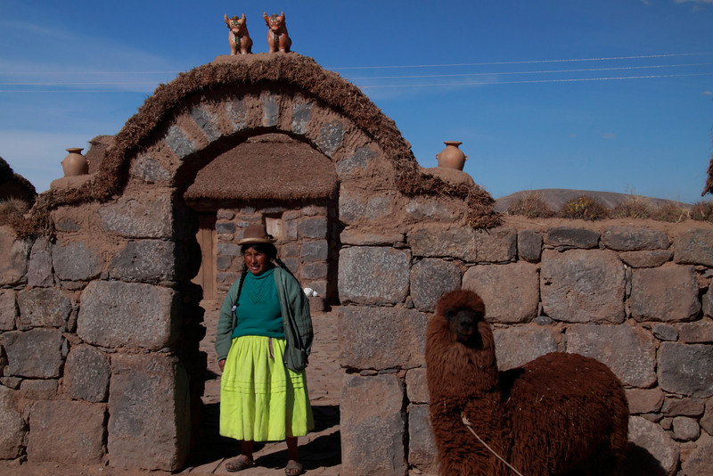 Family Farm 5821<br /> Lady greeting visitors at her family farm down the road from the Sillustani ruins.