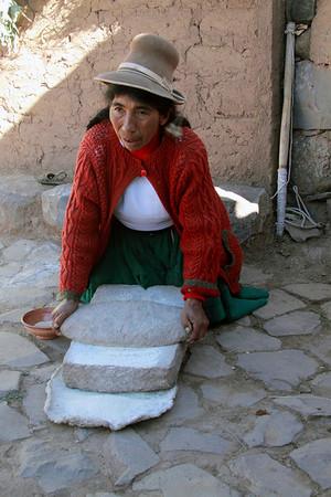 Family Farm 5830<br /> Preparing flour with grinding stones.