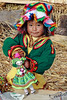 Titicaca 5645<br /> Little Uruos girl with her doll on a floating island on Lake Titicaca.