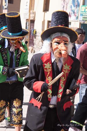 Ollantambo 1-13<br /> Dancers parading down the street in Ollantambo.