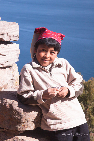 Titicaca 5484<br /> Standing by archway on the island in Lake Titicaca.