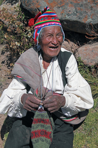Titicaca 5382<br /> Old man with his bag of coco leaves on the Port Alsuno trail on Taquile island on Lake Titicaca