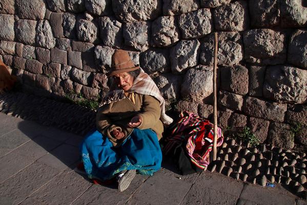 Cusco 3643<br /> Lady sitting on the street in Cusco.