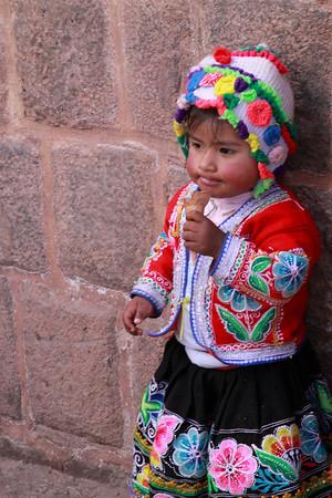 Cusco 3578<br /> Little girl having an ice cream cone in Cusco.