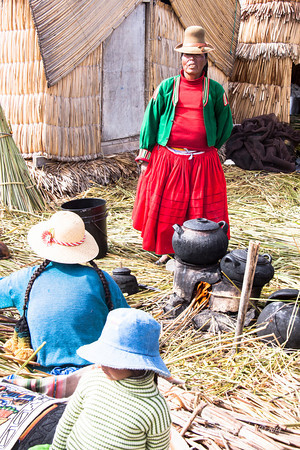 Titicaca 5717<br /> Cooking lunch on a Uros Island on Lake Titicaca.