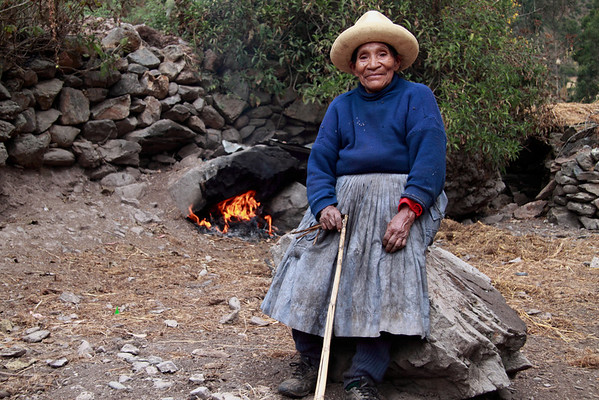 Ollantambo 4738<br /> Lady tending the fire to create smoke which will bring rain.