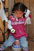 Pisac 4010<br /> Little girl having an ice cream cone at the Pisac Market while her mother takes care of the stand they have.
