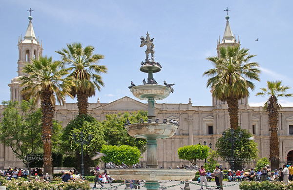 The fountain in the center of Plaza de Armas with the large Cathedral in the background, Arequipa, called the white city, Peru
