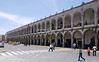 Two-story colonnades frame the Plaza De Armas in Arequipa, Peru