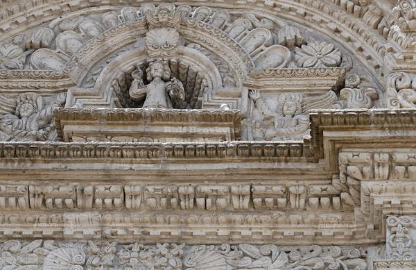 Study of the stucco reliefs, carved in sillar stone, above the main entrance of the church La Compañia de Jesus in Arequipa, Perú