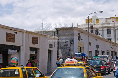 A busy street in Arequipa in southern Peru with the snow covered El Misti volcano looming in the background