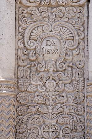 Elaborate stucco reliefs, carved in sillar stone, decorate the facade of the church La Compañia de Jesus in Arequipa, Perú