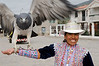 Peruvian woman presenting an eagle with spread wings in the small village of Yanque, Colca Canyon, Peru