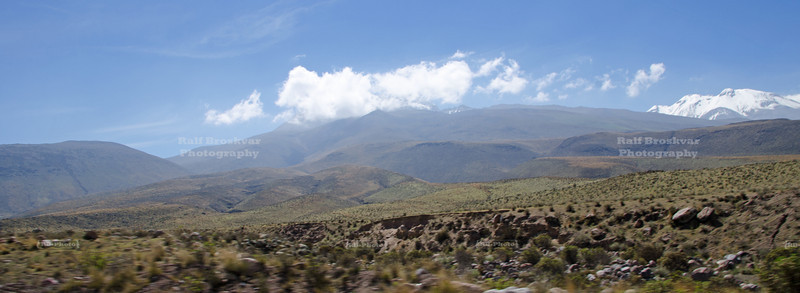 Clouds are  gathering over the snow capped mountains near Arequipa, Peru