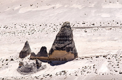 Cone shaped rock formations on a windswept ridge in the highlands of Pampa Canahuas National Reserve near Arequipa, Peru
