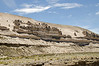Bizarre rock formations on a windswept ridge in the highlands of Pampa Canahuas National Reserve near Arequipa, Peru