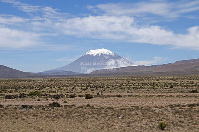 The 'back side' of the snow-capped volcano El Misti; The city of Arequipa, the second largest city in Peru, was buit on the front slope of this volcano.The stratovolcano stands at 5,822 m (19,101 ft) above sea level. The last eruption was in 1985.